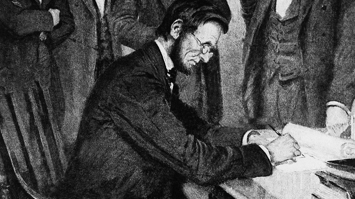 President Lincoln signs the Emancipation Proclamation