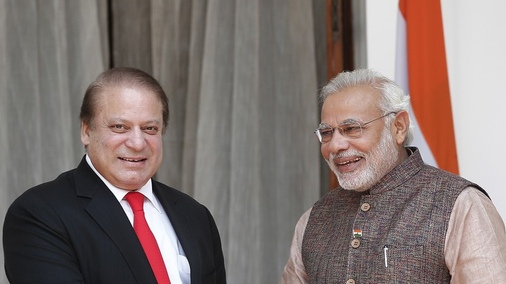 India Prime Minister Narendra Modi (R) and his Pakistani counterpart Nawaz Sharif smile before the start of their bilateral meeting in New Delhi May 27, 2014.