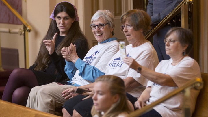 Supporters of Medicaid expansion in Virginia watch the state Senate's vote.