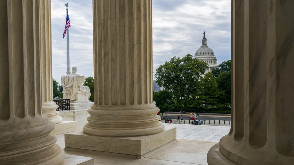 The Capitol is framed by the columns at the U.S. Supreme Court, in Washington, D.C.