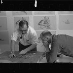 Eero Saarinen looks over an architectural model with Kevin Roche in their Michigan office.