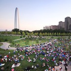 Crowds take in a concert on the newly redesigned grounds of the Gateway Arch in St. Louis.