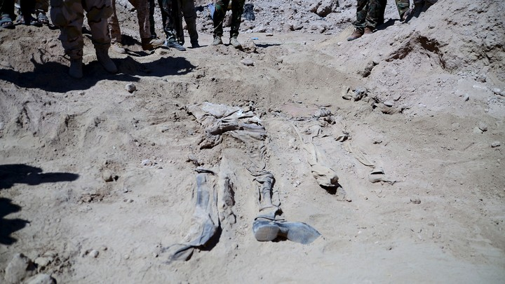Remnants of bodies of Shiite soldiers who have been killed by Islamic State militants are seen at a mass grave in Tikrit, Iraq.