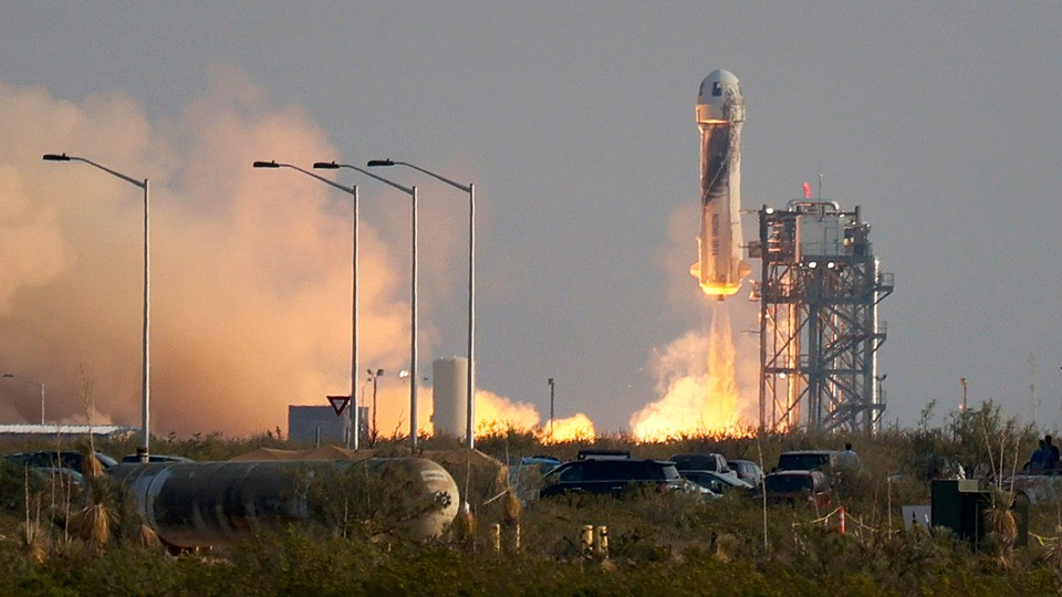 The New Shepard Blue Origin rocket lifts-off from the launch pad