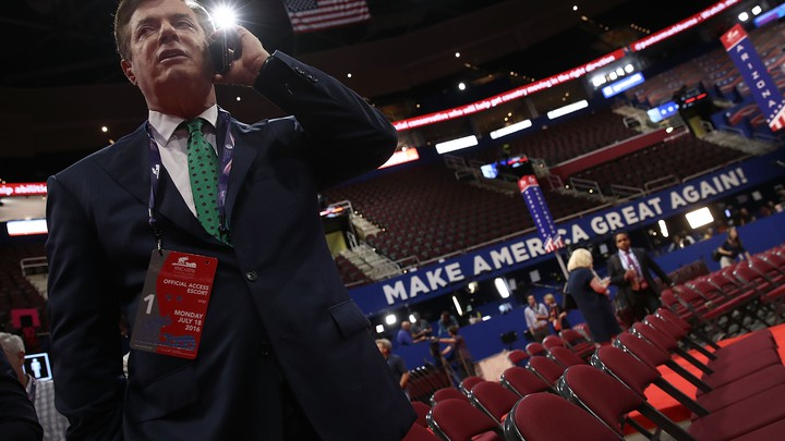 Former Trump campaign chairman Paul Manafort takes a phone call on the floor of the Republican National Convention in 2016.