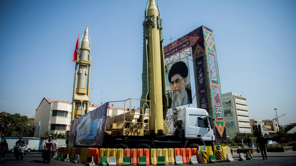 A display with missiles and a portrait of Ayatollah Ali Khamanei