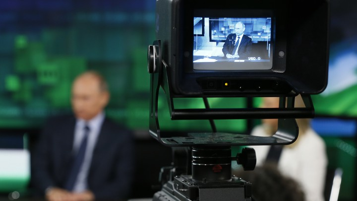 Russian President Vladimir Putin is interviewed at the headquarters of RT in Moscow.