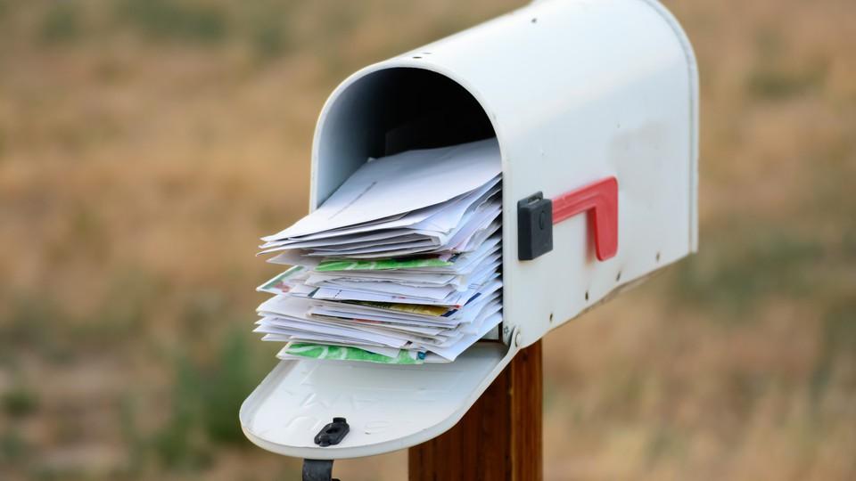 An overflowing mailbox