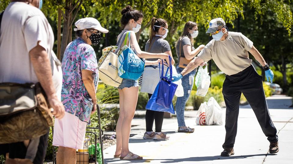 A food-bank volunteer handing out food