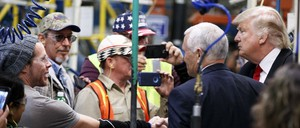 Donald Trump and Mike Pence with workers on a factory floor