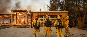 photo: Firefighters survey a home burning along Highway 128 during the Kincade fire in Healdsburg, California, in October 2019.
