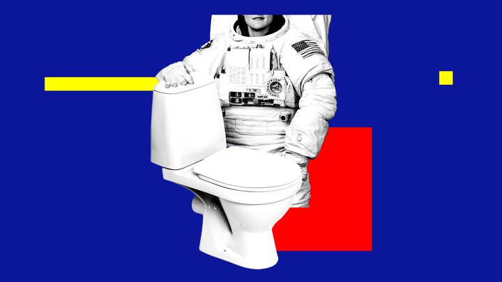 An astronaut standing next to a toilet