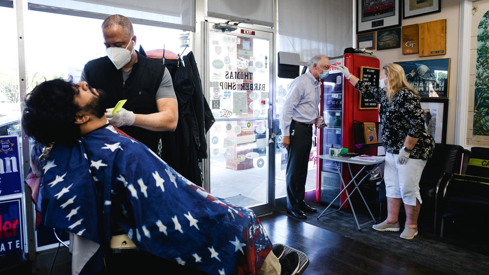 A recently reopened barbershop in Atlanta, Georgia, where people are wearing masks