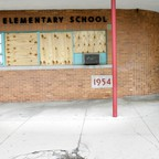Boards cover windows of a shuttered elementary school in Chester, Pennsylvania.