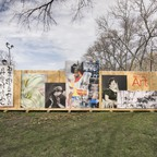 A constructed fence featuring a range of paintings and art