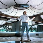 63 year-old Bill Tonnesen standing inside of an art installation located in a two-story commercial building