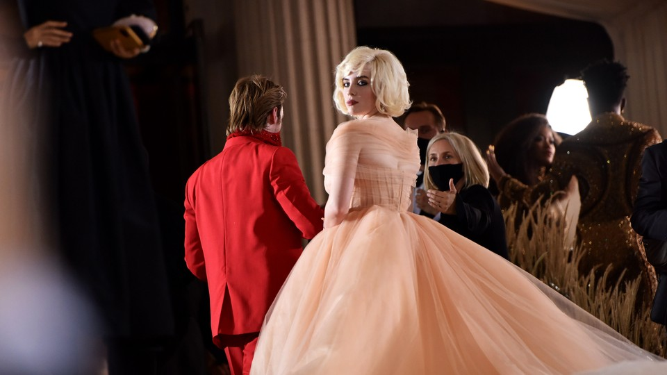 Billie Eilish in a pale-peach floor-length Oscar de la Renta gown