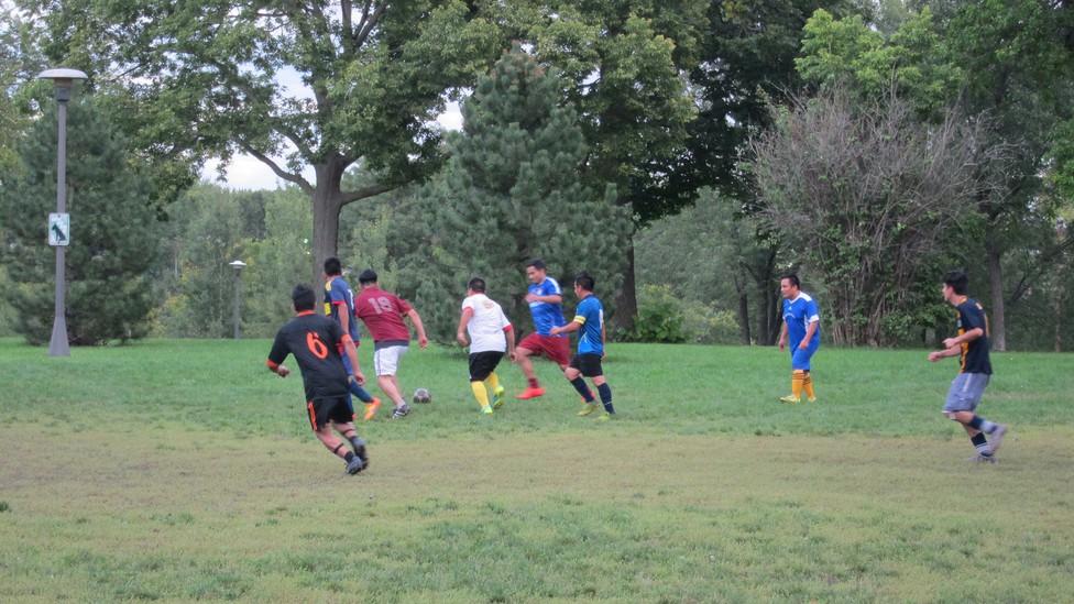 Ecuadorian immigrants play soccer in Powderhorn Park in Minneapolis.