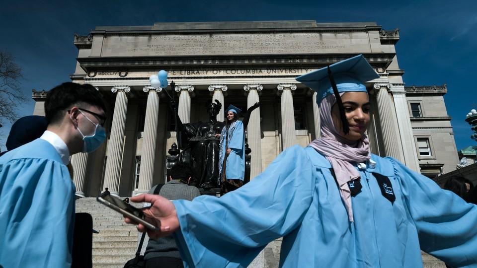 Seniors at Columbia University taking graduation photos on March 15, 2020.