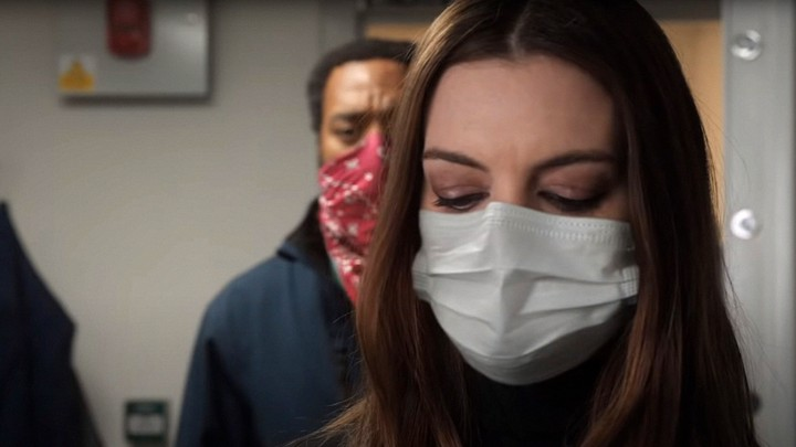 Anne Hathaway and Chiwetel Ejiofor wearing masks in the movie 'Locked Down'