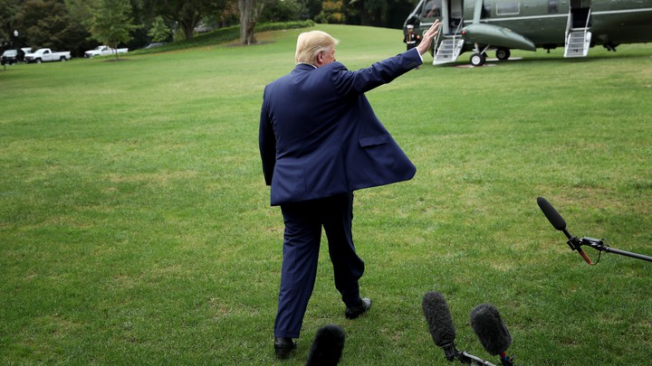 Photo of Trump waving to press as he leaves White House