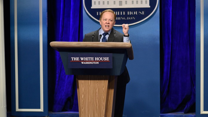 Melissa McCarthy as the White House Press Secretary Sean Spicer