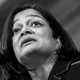 Representative Pramila Jayapal speaks into a microphone
