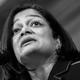 Representative Pramila Jayapal speaks into a microphone