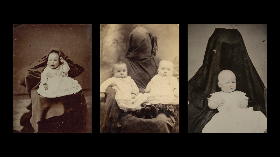 Black-and-white portraits of babies held by women hidden behind fabric