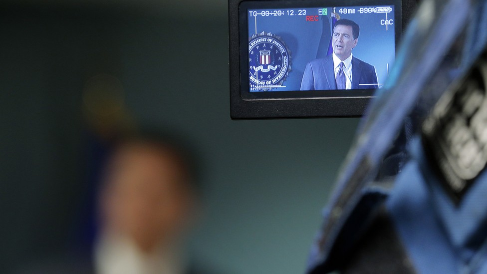 Cameras record former FBI Director James Comey during a news conference in Boston, Massachusetts on November 18, 2014.