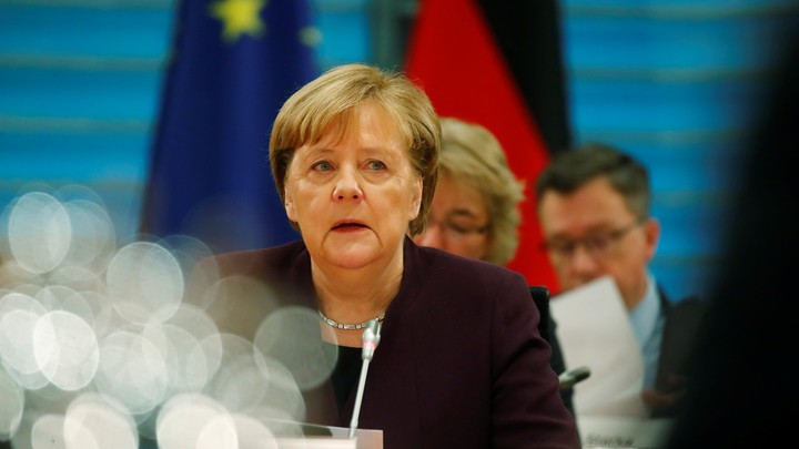 Angela Merkel sits in the Chancellery in Berlin for a meeting.