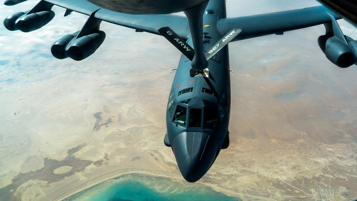 A U.S. Air Force B-52H Stratofortress from Minot Air Force Base, N.D., is refueled by a KC-135 Stratotanker in the U.S. Central Command area of responsibility Dec. 30, 2020.