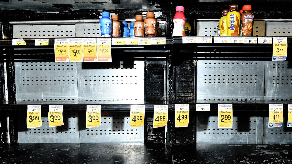 An almost empty grocery aisle.
