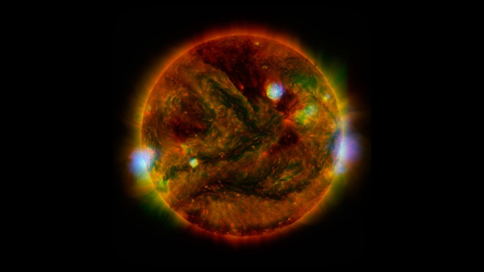 Regions of the sun highlighted in red, orange, green, blue, and other colors