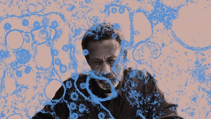 An illustration of a black man with coronavirus imagery surrounding him.