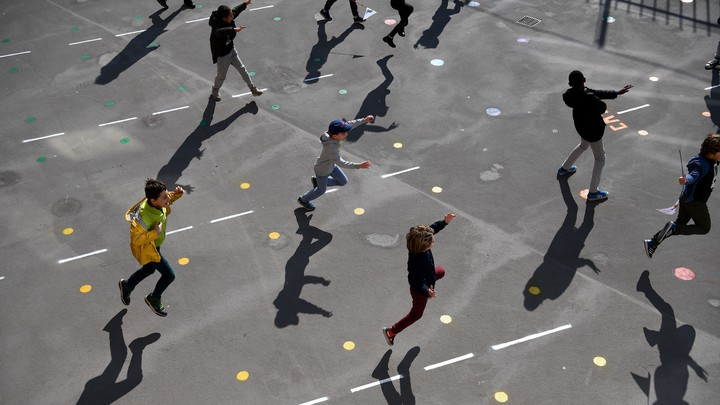 Students playing outside of reopened schools in Paris on May 14