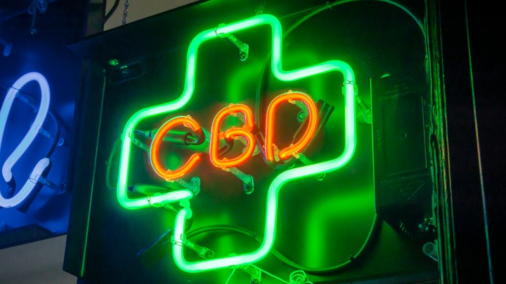 A green-and-red neon sign for CBD