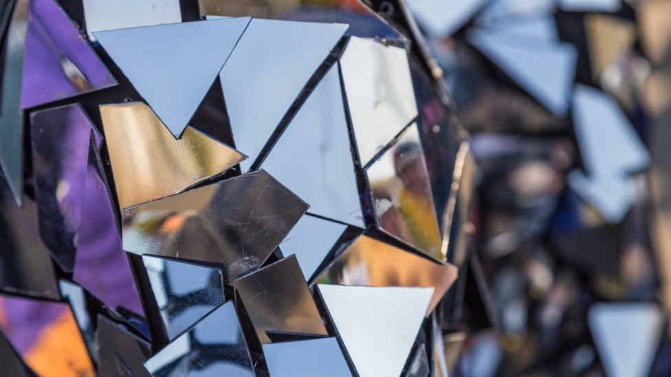 A sculpture made of small polygonal mirrors