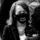"Representative Lisa Blunt Rochester wearing a ""good trouble"" mask"