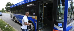 photo: A man boards a bus in Kansas City, Missouri.