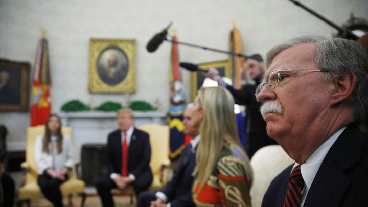 John Bolton sits in on a meeting with President Donald Trump, Vice President Mike Pence, Ivanka Trump, and Fabiana Rosales in the Oval Office.