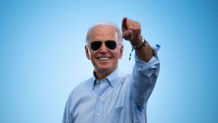 Joe Biden gestures to a crowd before delivering remarks at a drive-in rally in Coconut Creek, Florida.
