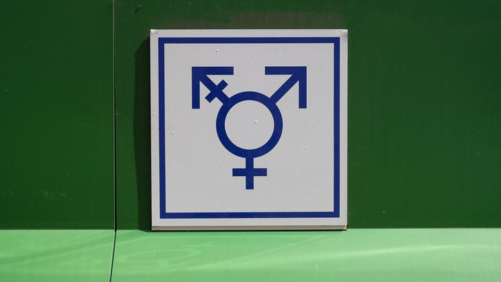 a sign for an all-gender bathroom