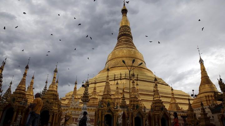 The Shwedagon Pagoda in Yangon, Burma, on a cloudy day