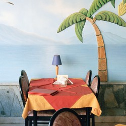 Painting of tropical scene in restaurant in Greece
