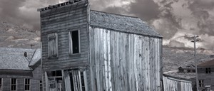 A photograph of the abandoned wooden buildings in a Western ghost town.