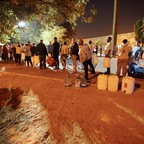 People line up to collect water from a spring in the Newlands suburb of Cape Town.
