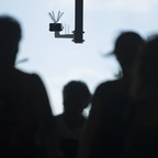A photo of passersby walking under a surveillance camera that is part of a facial recognition technology test at Berlin Suedkreuz station in Berlin, Germany.