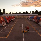 A child plays in a city-sanctioned encampment for homeless families in San Diego.