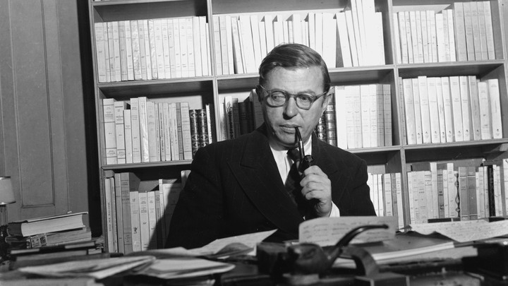The French philosopher Jean-Paul Sartre in his study in Paris in 1948